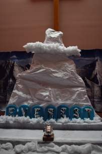 EVEREST Stage- We created three mountains out of wood and white bulletin board paper. It was less expensive and at disposable time -better for the environment.  We followed the directions Group provides for the large cloud at the top of the mountain. Our letters are made out of kickboards from the dollar store. The backdrop we purchased from Group.